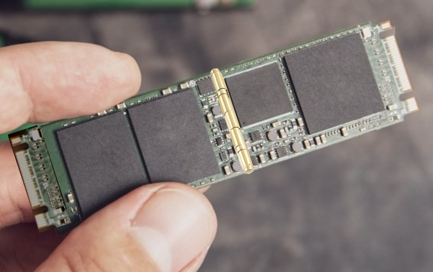Hand holding hinged m.2 SSD